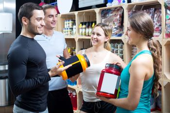 adults discussing bodybuilding supplements