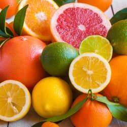 a collection of citrus fruits including oranges, grapefruits, lemons and limes