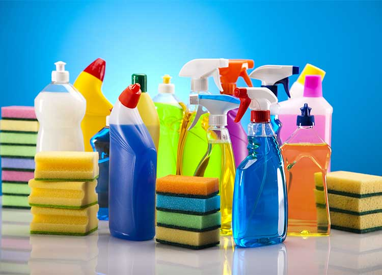Assorted Spray Cleaning Supplies On Table