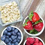 Assortment of Fresh Berries and Nuts on Table