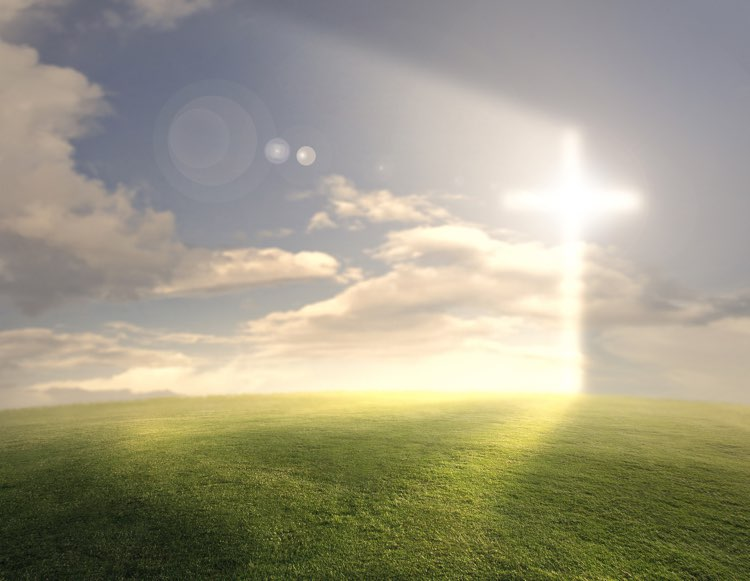 Cross of Jesus Christ shining through the clouds