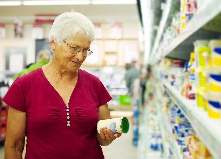 Elderly Woman Checking Food Label