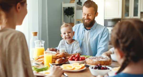 family having breakfast together in kitchen