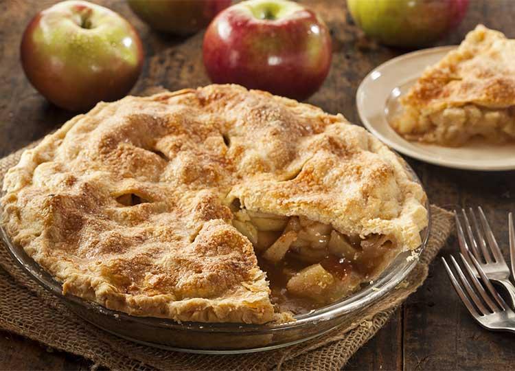 fresh apple pie on wooden table