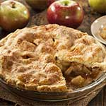 fresh apple pie on wooden table