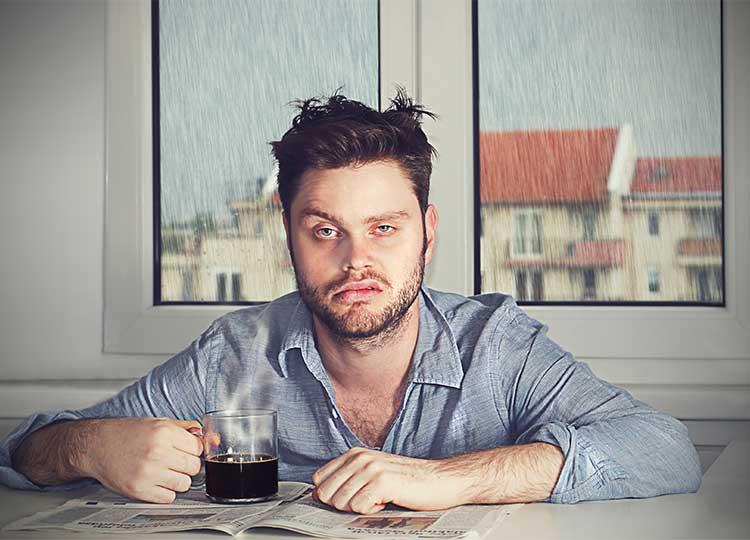 Grumpy Man Inside House Drinking Coffee
