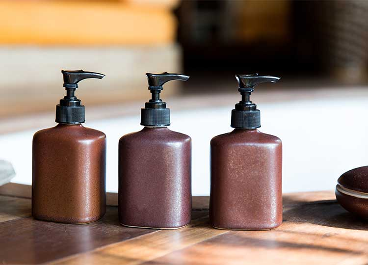 Brown Lotion Bottles on Table
