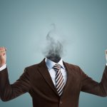 Man In Suit With Head Exploding Into Smoke