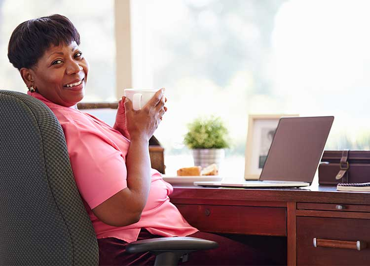 Middle-aged Black Woman Sitting in Office