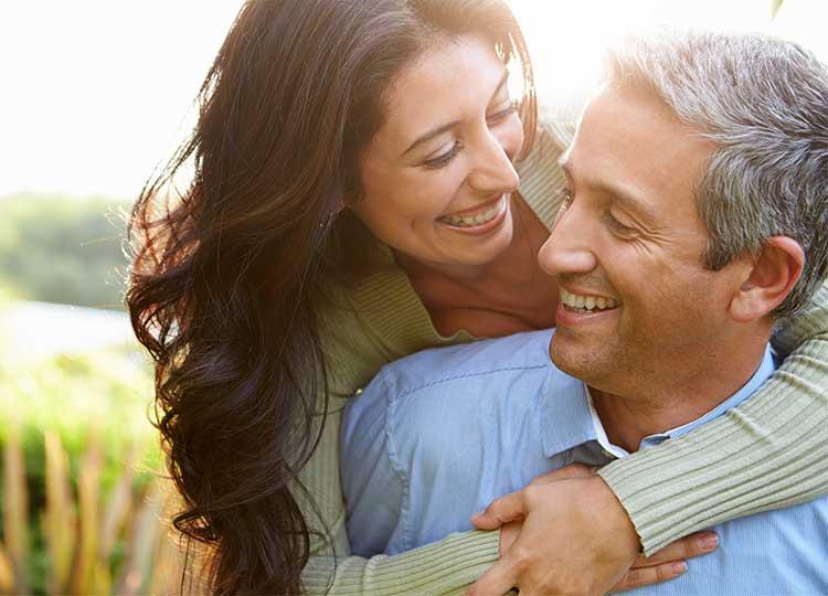 Middle-aged Hispanic Couple Hugging Outside