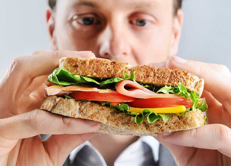 Middle-aged Man Tempted by Sandwich