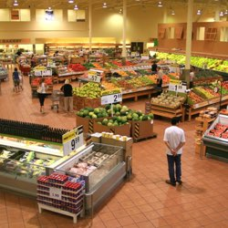 outer isles of a modern grocery store contain fresh, whole foods
