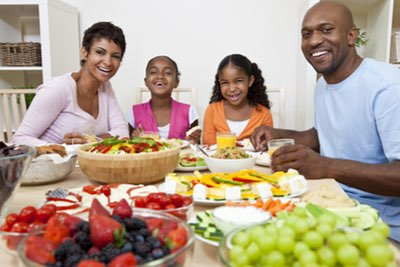 Attractive, young black family enjoying a healthy meal together.