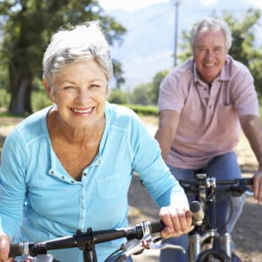 senior couple getting exercise on a fun bike ride