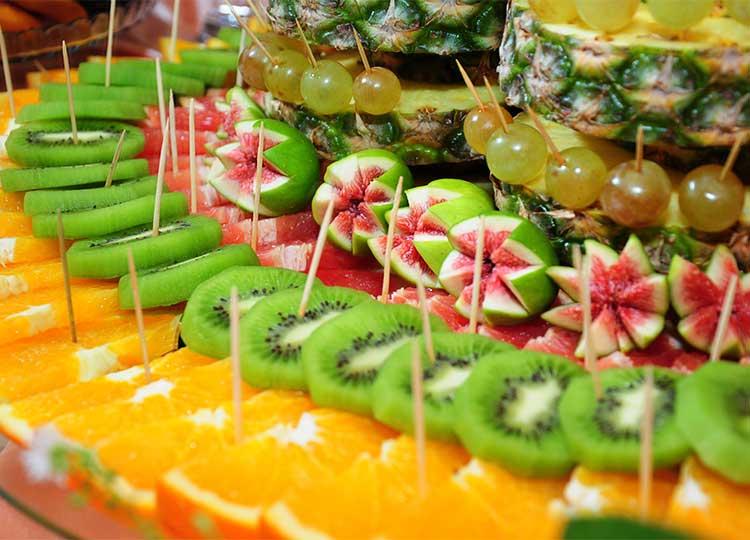 Sliced fruit assortment on platter