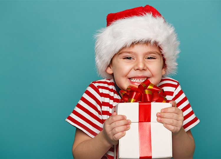 Small Boy with Christmas Hat and Present