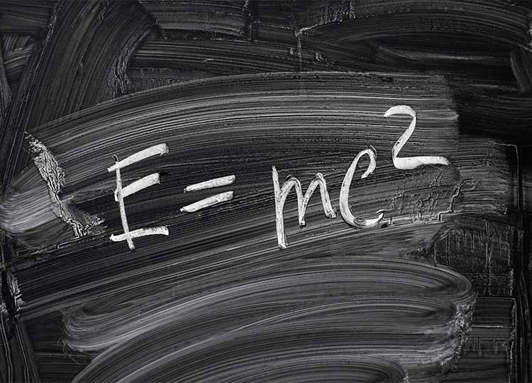 Theory of Relativity written on green chalkboard