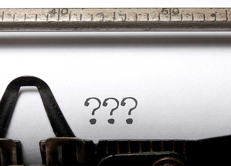 Typewriter with question Marks on Page