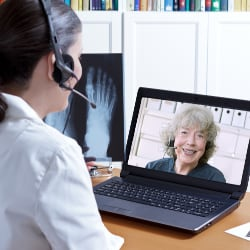 healthcare provider consulting with patient via a video conference on the internet
