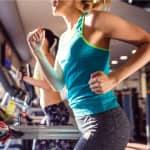 two ladies running on treadmills