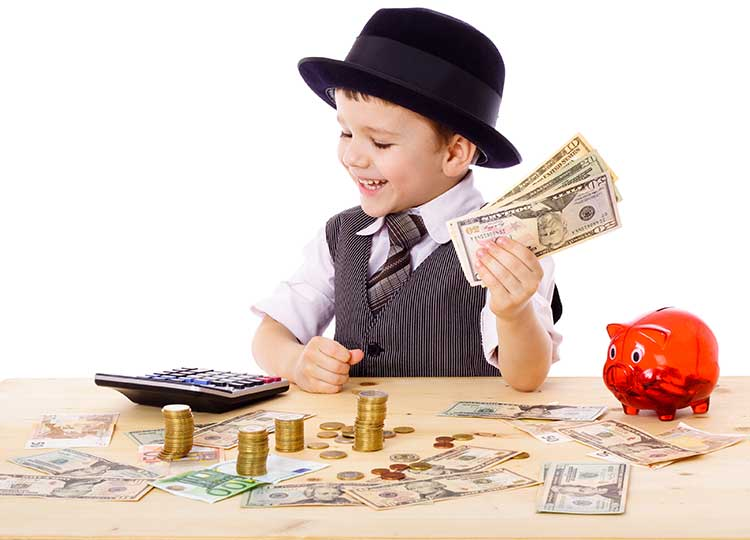 young boy in suit holding money